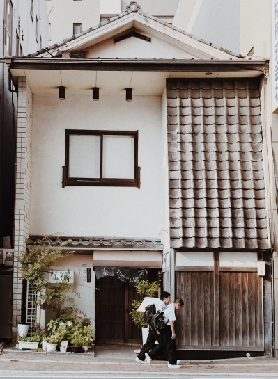 typical japanese students and a beautiful house
